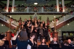 Snow fell from the rafters as the Hill Singers led the crowd in the singing of Christmas carols.