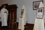 Fr. Mulligan blesses portraits of St. Pope John XXIII and Pope Francis
