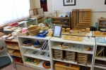 A typical Montessori classroom consists of five learning areas including practical life, which is depicted above