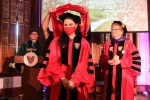 student receives doctoral hood
