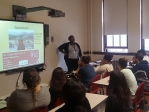 Trachanda showing students slide show about studying abroad