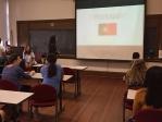 Students watching slide presentation