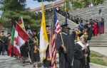 Aaron Abdullah carries the American flag at CHC's Commencement in May 2016. He earned his B.S. through SCPS and also earned his M.Ed. at CHC. Abdullah also is a military veteran.