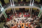 Snow falls in the rotunda during this year's Carol Night celebration. (Photo by Margo Reed)