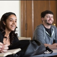 Female and Male Student in Class Smiling