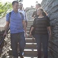 4 students walking down steps