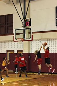 Head women's basketball coach, Mike West, puts up a shot during the staff vs students' game, which is part of the annual Mission & Legacy Week held in late September.
