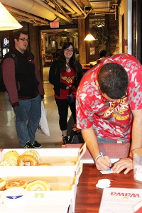 Kristian Hernandez '20 fills out a raffle form at the free breakfast event for commuters on Monday morning. The breakfast kicked off Commuter Appreciation Week.