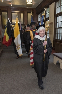 As the most tenured member of the faculty, Sister Mary Helen Kashuba happily carries the mace at Chestnut Hill College's 90th Commencement last Saturday.