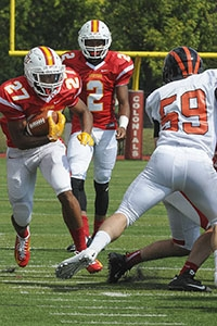 Dasante Callis scores the first rushing touchdown for the Griffins in the sprint football inaugural game