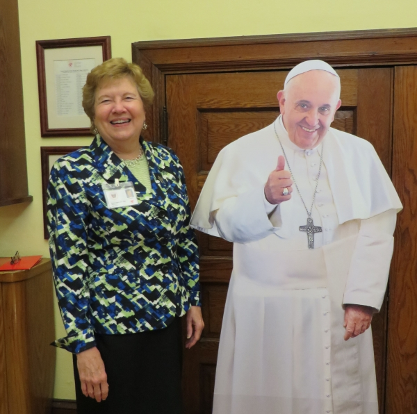 sister carol with pope cut out